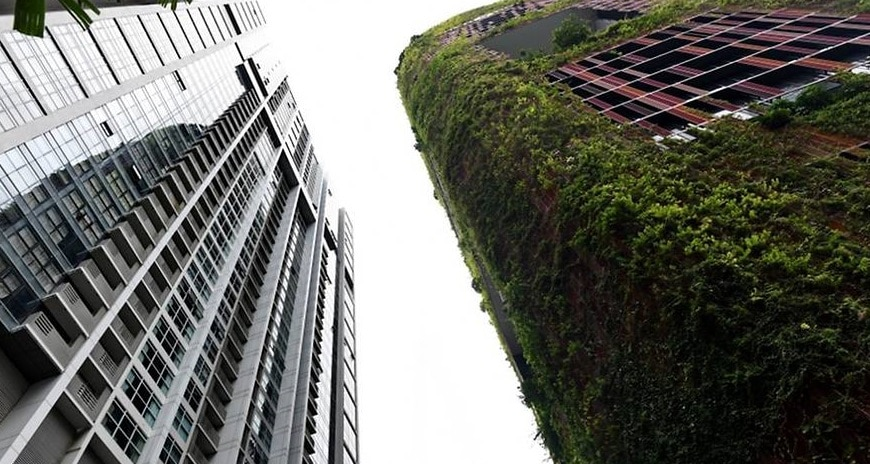 A view of a residential apartment (left) and Oasia hotel in Singapore on Jun 19, 2018